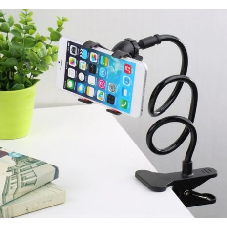 The holder of the smartphone on clip . On the table, headboard, chair, car on clothespin.