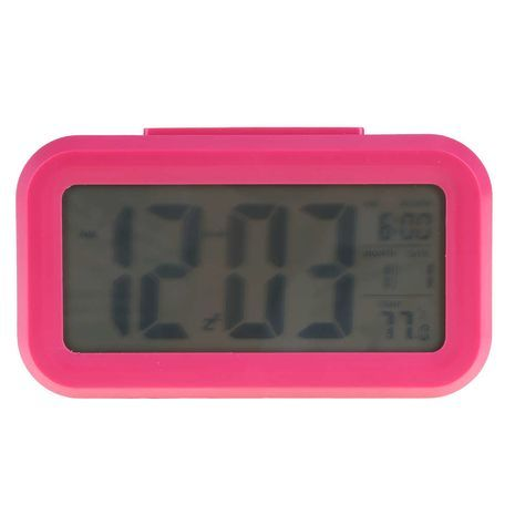 Digital  Alarm Clock with illumination automatically triggered by the onset of darkness Sakal